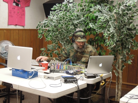 Brian B. James opened the 24-hour Day of Noise. The potted trees, collected from around the station, were set up in the studio for the sake of the webcast, which we ran on UStream throughout the day/night.