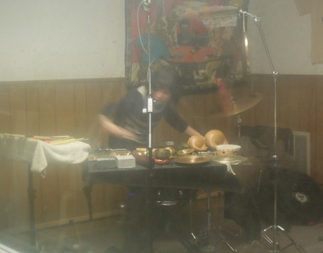 Revenant percussionist Nava Dunkelman, captured through the hazy Studio A window.