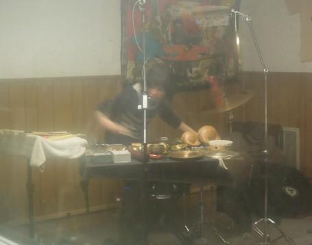 Revenant percussionist Nava Dunkelman, captured through the hazy Studio A window.