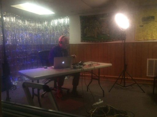 Chris Brown, professor emeritus of Mills College, performing under the name Tangled Web. Photo taken from the control booth; the haziness is due to the thick, decades-old glass separating the booth from Studio A.
